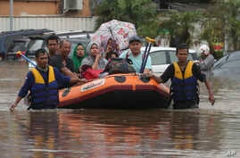Indonesia rescue team evacuate residents from their flooded house at Jatibening on the outskirt of Jakarta, Indonesia,…
