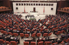 Members of Turkey's parliament vote to send Turkish troops to Libya to help the U.N.-supported government in Tripoli battle forces loyal to a rival administration in eastern Libya that is seeking to capture the capital, in Ankara, Turkey, Jan. 2, 2020.