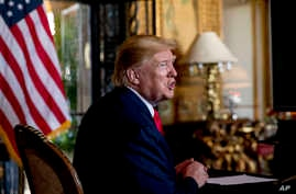 FILE - In this Dec. 24, 2019 photo, President Donald Trump speaks to members of the media following a Christmas Eve video…
