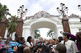Lawmaker José Brito speaks to the press outside the National Assembly where opposition leader Juan Guaido is to lead a session to elect new Assembly leadership in Caracas, Venezuela, Jan. 5, 2020.