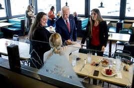 Democratic presidential candidate former Vice President Joe Biden greets guests at Ross' Restaurant, Monday, Jan. 6, 2020, in…