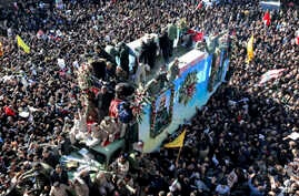 Coffins of Gen. Qassem Soleimani and others who were killed in Iraq by a U.S. drone strike, are carried on a truck