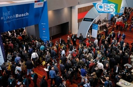 Crowds enter the convention center on the first day of the CES tech show, Tuesday, Jan. 7, 2020, in Las Vegas. (AP Photo/John…