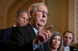 Senate Majority Leader Mitch McConnell, R-Ky., joined by Majority Whip John Thune, R-S.D., left, and Sen. Joni Ernst, R-Iowa, talks to reporters at the Capitol in Washington, Jan. 7, 2020.
