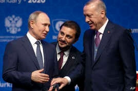Turkey's President Recep Tayyip Erdogan, right and Russia's President Vladimir Putin, left, talk after they symbolically open a valve during a ceremony in Istanbul for the inauguration of the TurkStream pipeline, Jan. 8, 2020.