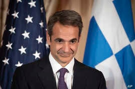 Greek Prime Minister Kyriakos Mitsotakis appears at a reception, at the State Department in Washington, Wednesday, Jan. 8, 2020…