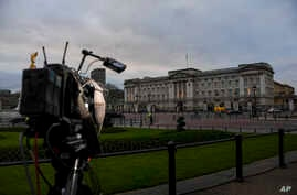 Media cameras outside Buckingham Palace, in London, Friday, Jan. 10, 2020. In a statement Prince Harry and his wife, Meghan,…