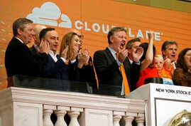 FILE - Cloudflare co-founder and CEO Matthew Prince, right center, applauds during New York Stock Exchange opening bell ceremonies to celebrate his company's IPO, Sept. 13, 2019.