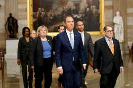 Impeachment managers walk through rotunda on their way to Senate on Capitol Hill, Jan. 16, 2020.