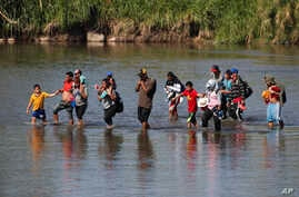Central American migrants cross the Suchiate River from Mexico to Guatemala, near Tecun Uman, Guatemala, Jan. 21, 2020.