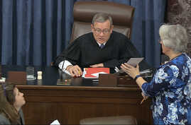 Supreme Court Chief Justice John Roberts reads the results of the vote on approving rules of impeachment.