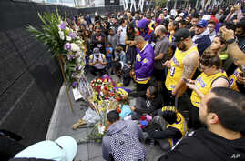 Fans of Kobe Bryant mourn at a memorial to him in front of Staples Center, home of the Los Angeles Lakers.