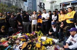People gather at a memorial for Kobe Bryant near Staples Center, Jan. 26, 2020, in Los Angeles.