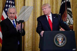 President Donald Trump pauses as he speaks during an event with Israeli Prime Minister Benjamin Netanyahu in the East Room.