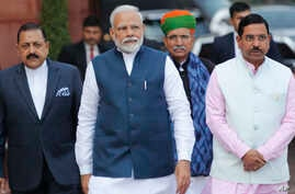 Indian Prime Minister Narendra Modi, center, with his cabinet colleagues arrive at the Parliament House on the opening day of the budget session in New Delhi, India, Jan. 31, 2020.