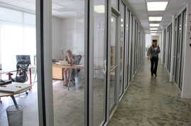 Workers  inside one of the business incubator buildings of the Charleston Digital Corridor in Charleston, S.C., are seen in…