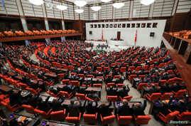 Turkish lawmakers vote a bill that allows troop deployment to Libya, at the Parliament in Ankara, Turkey, January 2, 2020…