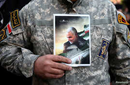 A demonstrator holds the picture of Qassem Soleimani during a protest against the assassination of the Iranian Major-General…