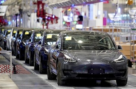 Tesla China-made Model 3 vehicles are seen during a delivery event at its factory in Shanghai, China January 7, 2020. REUTERS…