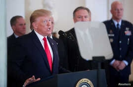 U.S. President Donald Trump delivers a statement on Iran's missile attacks on U.S.-led forces in Iraq, in the Grand Foyer at…