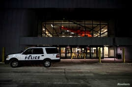 A police car is seen at a closed terminal before the arrival of an aircraft chartered by the U.S. State Department to evacuate…
