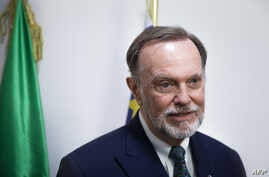 Tibor P. Nagy, U.S. Assistant Secretary for African Affairs, gives a press conference in a room of the presidency of the Central African Republic, Jan. 20, 2020.