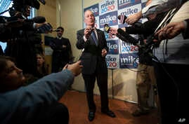 FILE - Democratic presidential candidate Michael Bloomberg speaks to reporters after a campaign event, in Burlington, Vermont, Jan. 27, 2020.