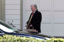 FILE - Former national security adviser John Bolton leaves his home in Bethesda, Maryland, Jan. 28, 2020.