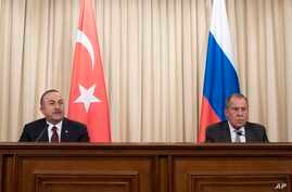Turkish Foreign Minister Mevlut Cavusoglu, left, and Russian Foreign Minister Sergey Lavrov attend a joint news conference following their talks in Moscow, Russia, Jan. 13, 2020.