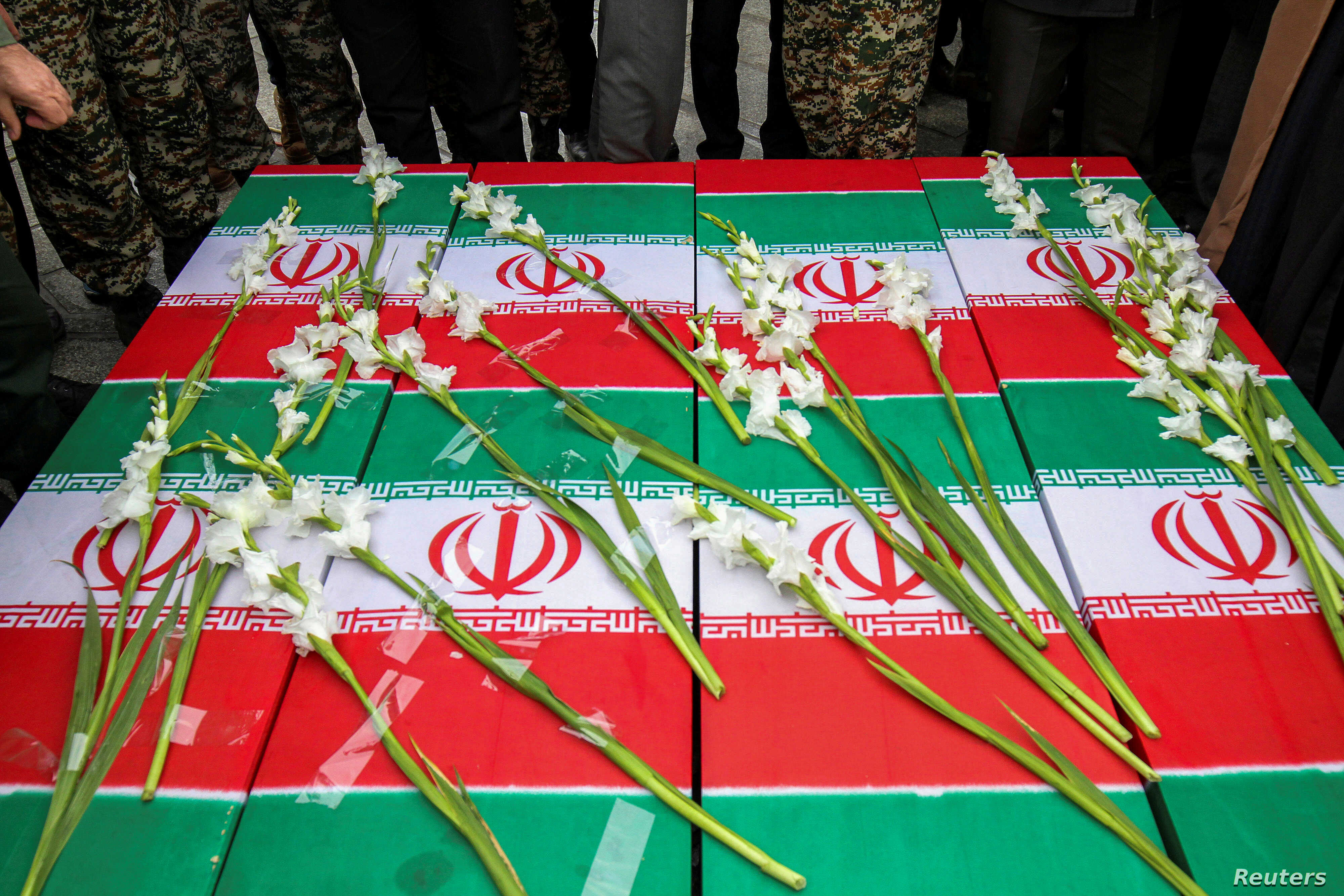 Coffins of four Iranian victims of the downing by Iran of a Ukrainian airliner are seen during the victims' funeral in Hamadan, Iran, Jan. 16, 2020.