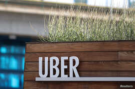 FILE - Signage for an Uber hub is seen in Redondo Beach, California, March 25, 2019.