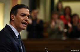 Spain's acting Prime Minister Pedro Sanchez speaks during the investiture debate at the Parliament in Madrid, Jan. 5, 2020.