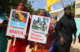 "Somali women chant slogans and hold placards written in Somali ""No more Explosions"" and ""Silly criminal is Dangerous"" as they…"