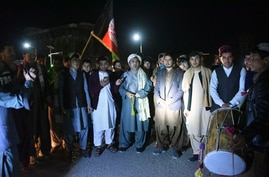 Youths and peace activists gather to celebrate the reduction in violence, in Kandahar, Feb. 21, 2020. A weeklong partial truce took hold across Afghanistan Saturday, as the war-weary country woke up to what is potentially a major turning point in its war.