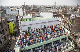 Muslim devotees offer Friday prayers at a mosque following sectarian riots over India's new citizenship law, at Mustafabad area…