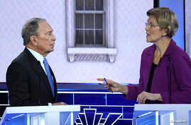 Former New York City Mayor Mike Bloomberg talks with Senator Elizabeth Warren during a break at the ninth Democratic 2020 debate