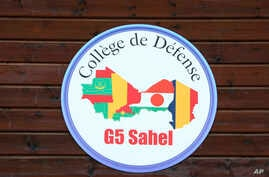 """This pictured taken Monday, July 2, 2018 shows the logo of five-nation French-backed anti-terror unit, the """"G5 Sahel"""" force, in…"""