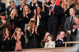 FILE - First Lady Melania Trump and guests in the first lady's box applaud during the 2019 State of the Union address.