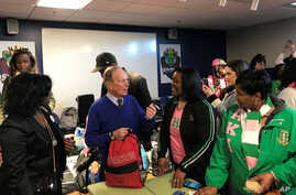 Former New York City Mayor and presidential candidate Michael Bloomberg talks to volunteers in Little Rock, Arkansas
