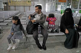 A Yemeni family waits in the departure hall at Sanaa International airport for a U.N. flight, Yemen, Monday, Feb. 3, 2020. The…