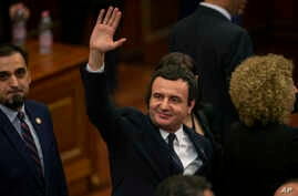 Albin Kurti, the newly elected prime minister of Kosovo waves after a new government was elected, in the capital Pristina, Feb. 3, 2020.