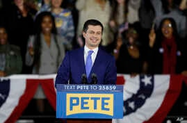 Democratic presidential candidate former South Bend, Ind., Mayor Pete Buttigieg speaks to supporters at a caucus night event