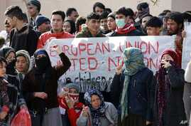 Migrants shout slogans during a protest in Mytilene port, on the northeastern Aegean island of Lesbos, Greece, on Tuesday, Feb…