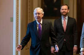 Senate Majority Leader Mitch McConnell of Ky., left, walks from the Senate Floor on Capitol Hill, Feb. 4, 2020 in Washington.