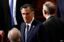 Sen. Mitt Romney, R-Utah, arrives before President Donald Trump delivers his State of the Union address