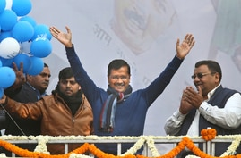 "Incumbent Delhi Chief Minister Arvind Kejriwal, center, waves at Aam Aadmi Party, or ""common man's"" party headquarters as they celebrate the party's victory in New Delhi, India, Feb. 11, 2020."