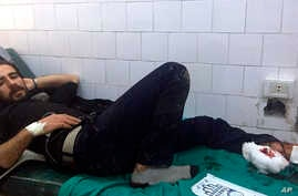 In this photo released by the Syrian official news agency SANA, A Syrian man receives treatment after U.S. troops opened fire on locals who tried to block a U.S. convoy driving near the village Khirbet Ammu, east of Qamishli city, Syria, Feb. 12, 2020.