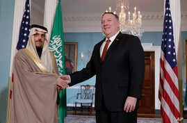 Secretary of State Mike Pompeo, right, shakes hands with Saudi Foreign Minister Faisal bin Farhan Al Saud,  Feb. 12.