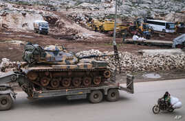 Turkish army artillery arrives in the east of Idlib, Syria, Saturday, Feb. 15, 2020. Turkish Foreign Minister Mevlut Cavusoglu…