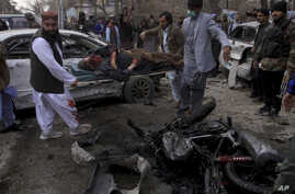 Pakistani volunteers remove a victim at the site of a suicide bombing in Quetta, Pakistan, Feb. 17, 2020.